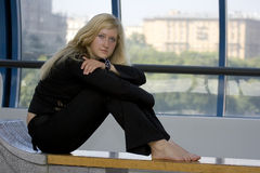 Of the sitting woman. Portrait of the sitting young woman with blond hair Stock Image