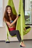 Sitting woman in anti-gravity aerial yoga portrait Stock Image