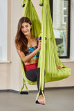 Sitting woman in anti-gravity aerial yoga Stock Images
