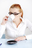 Sitting woman drinking coffee. Stock Image