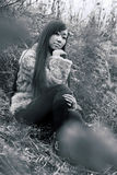 Sitting woman in field. Asian woman sitting in field stock images
