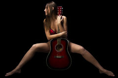 Sitting woman with guitar Royalty Free Stock Photography