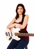 Sitting woman with guitar. Royalty Free Stock Photo
