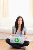 Sitting woman holding recycling bin Royalty Free Stock Image