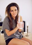 Sitting Woman at Home with a Cup of Coffee Royalty Free Stock Photography