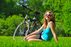 Sitting woman near her bike Royalty Free Stock Images