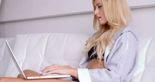 Sitting Woman in an Open Sleep Robe with Laptop stock video footage