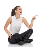 Sitting Woman Pointing Royalty Free Stock Images