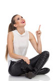 Sitting Woman Pointing Up Stock Photos