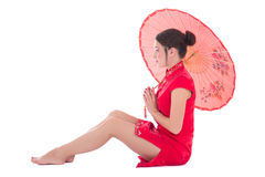 Sitting woman in red japanese dress with umbrella isolated on wh Royalty Free Stock Photography