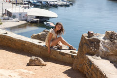 Sitting woman at sea coast on  island Royalty Free Stock Photo