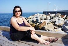 Sitting woman seaside Stock Photography