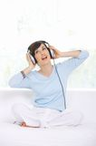 Sitting Woman Wearing Headphones and Singing Royalty Free Stock Photography