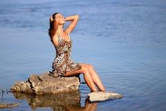 Sitting Woman Wearing Leopard Tank Mini Dress on Body of Water Royalty Free Stock Photos