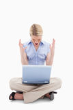 Sitting woman yelling at her laptop Stock Photo