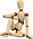 Sitting wooden doll Royalty Free Stock Images
