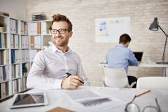 Sitting by workplace Royalty Free Stock Images