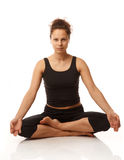 Sitting in yoga pose Stock Photo