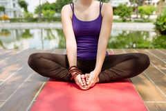Sitting in yoga position Royalty Free Stock Image