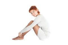 Sitting young beautiful woman Royalty Free Stock Photo