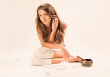 Sitting young beautiful woman SPA relaxing Stock Image