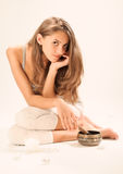 Sitting young beautiful woman SPA relaxing Royalty Free Stock Image