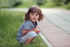 Sitting young boy Royalty Free Stock Image