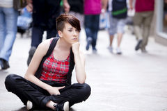 Sitting young girl. Stock Images