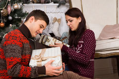 Sitting Young Partners Holding Christmas Presents Royalty Free Stock Image