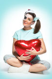 Sitting young woman with heart Royalty Free Stock Photos
