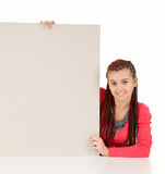 Sitting young woman showing blank billboard Stock Photography