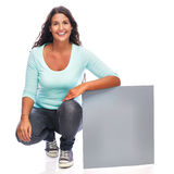 Sitting Young Woman Showing Sign Royalty Free Stock Photography