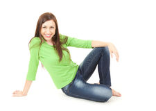 Sitting young woman, smiling, full length Royalty Free Stock Photography