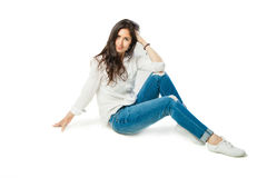 Sitting young woman in white shirt Royalty Free Stock Photo