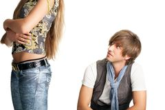 Sittng men looks at woman bottom Royalty Free Stock Photography