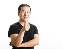 Situación asiática joven del hombre aislada en blanco Imagen de archivo libre de regalías