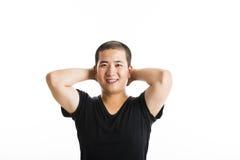 Situación asiática joven del hombre aislada en blanco Fotografía de archivo libre de regalías
