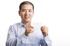 Situación joven del hombre de negocios aislada en blanco imagen de archivo libre de regalías