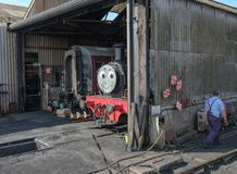 Children`s well-know train character seen on a full size steam locomotive. Situated in his engine shed, this steam engine is being prepared for anything outing Royalty Free Stock Photography