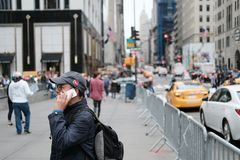 Adult male seen using a well known smartphone in New York. royalty free stock image