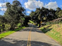 Lonesom Little Highway. Situated near Escondido, CA this road will lead you past several ranches, and an equestrian park Stock Photos