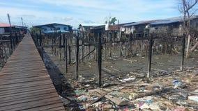 Situation après le feu dans Kampung Tanjung Batu Keramat Laut, Tawau, Sabah, Malaisie Images stock