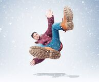 Situation, the man in red winter clothes is falling, around the snow. Concept of an accident.