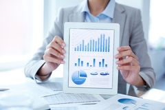 Situation on the market. Close-up of businesswoman presenting financial solution in touchpad Royalty Free Stock Photo