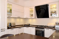 Situation of a modern kitchen-dining room Stock Photos