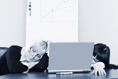 The situation in  office. Young businesswoman sleeps in  office Royalty Free Stock Photos