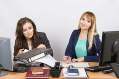 The situation in the office - one employee can handle the job, the other is not Stock Photo
