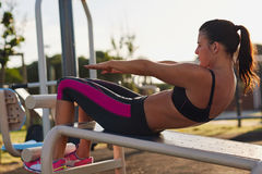 Situp woman. Fitness woman doing situps in outdoor gym woking out strength training Royalty Free Stock Photography