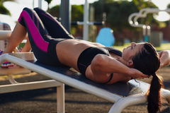 Situp woman. Fitness woman doing situps in outdoor gym woking out strength training Royalty Free Stock Photo