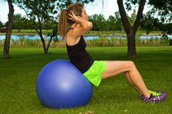 Situps on exercise ball Stock Image
